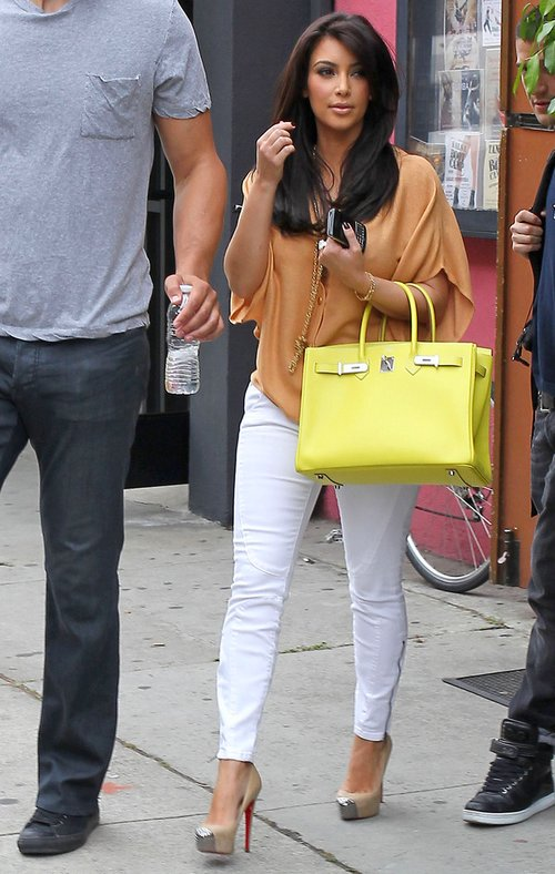 Kim Kardashian, fiance Kris Humphries and Mark Ballas are spotted leaving B & L Bakery